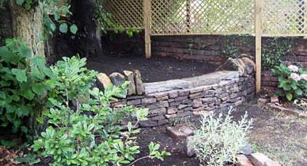 Dry stone garden wall and seating